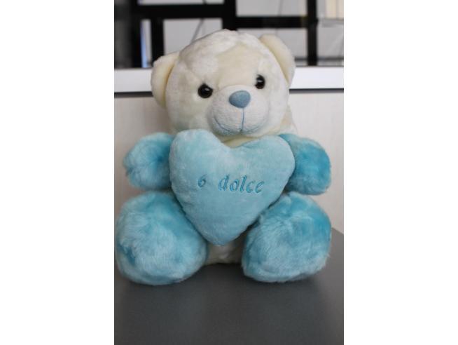Peluche Orso bianco con cappuccio bianco azzurro cuore 30 cm Peticoco